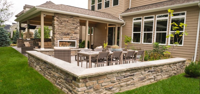 Outdoor living space with a custom veranda from Ground Works Land Design